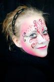 Muchacha sonriente hermosa con la pintura de la cara Imagen de archivo libre de regalías
