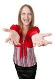 Muchacha sonriente hermosa en una blusa roja brillante Foto de archivo libre de regalías