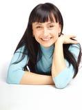 Muchacha sonriente hermosa que miente en suelo Imagen de archivo