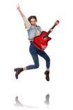 Muchacha sonriente joven con la guitarra aislada en Fotografía de archivo libre de regalías