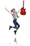 Muchacha sonriente joven con la guitarra aislada en blanco Imágenes de archivo libres de regalías