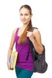 Muchacha sonriente joven del estudiante con las carpetas y la mochila Imagen de archivo libre de regalías