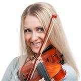 Muchacha sonriente joven que toca el violín Fotografía de archivo