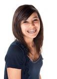 Muchacha sonriente linda con las paréntesis Imagen de archivo libre de regalías