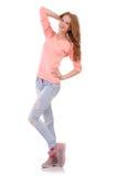 Muchacha sonriente linda en blusa rosada y vaqueros Imagen de archivo