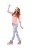 Muchacha sonriente linda en blusa rosada y vaqueros Fotografía de archivo libre de regalías