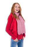 Muchacha sonriente linda en chaqueta roja y vaqueros aislados Fotografía de archivo libre de regalías