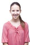 Muchacha sonriente positiva en un fondo blanco Fotos de archivo libres de regalías
