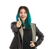 Muchacha sonriente que muestra el pulgar encima de la muestra Imagen de archivo