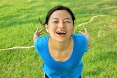 Muchacha sonriente sana en verde Imagen de archivo libre de regalías