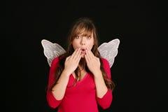 Muchacha sorprendida en alas de hadas Fotos de archivo libres de regalías