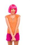 Muchacha tímida con el pelo rosado. Fotos de archivo libres de regalías