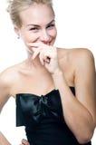 Muchacha tímida de risa Imagen de archivo libre de regalías