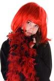 Muchacha tímida en peluca roja. Fotografía de archivo