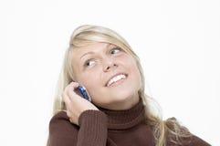 Muchacha/teléfono celular/blanco foto de archivo libre de regalías