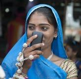 Muchacha tribal con el móvil Fotografía de archivo libre de regalías