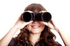 Muchacha triguena con binocular. Fotos de archivo libres de regalías