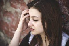 Muchacha triste con la cara motional Imagenes de archivo