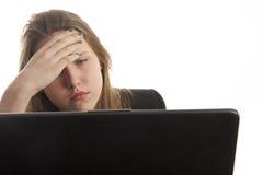 Muchacha triste con la computadora portátil Imagenes de archivo
