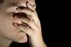 Muchacha triste con la mano en su cara Fotos de archivo