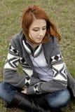 Muchacha triste con los auriculares Foto de archivo libre de regalías