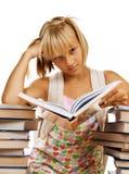Muchacha triste de la escuela con los libros Foto de archivo libre de regalías