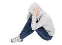 Muchacha triste del adolescente con la camiseta gris encapuchada Fotos de archivo libres de regalías