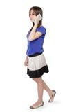 Muchacha triste en caminar del teléfono Foto de archivo libre de regalías