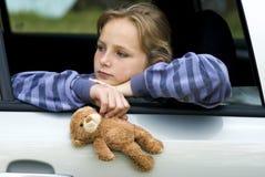 Muchacha triste en coche Imagen de archivo libre de regalías