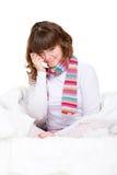 Muchacha triste en la cama Imagenes de archivo