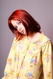 Muchacha triste en pijamas amarillos Foto de archivo libre de regalías