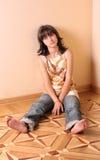 Muchacha triste en suelo Fotografía de archivo libre de regalías