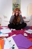 Muchacha triste entre las notas para el examen Fotografía de archivo libre de regalías