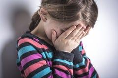 Muchacha triste subrayada en estudio Imagen de archivo libre de regalías