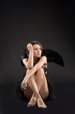 Muchacha vestida como imp Foto de archivo libre de regalías