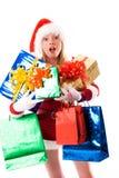 Muchacha vestida como Santa con los presentes Fotografía de archivo libre de regalías
