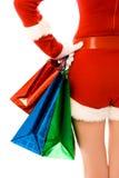 Muchacha vestida como Santa con los regalos de Navidad Fotos de archivo