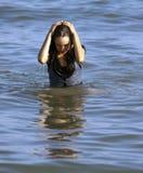 Muchacha vestida en el océano Foto de archivo