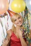 Muchacha vestida roja en partido con los globos Fotos de archivo libres de regalías