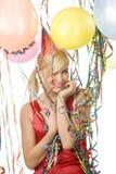 Muchacha vestida roja en partido con los globos Fotos de archivo