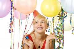 Muchacha vestida roja en partido con los globos Foto de archivo libre de regalías
