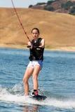 Muchacha wakeboarding imagenes de archivo