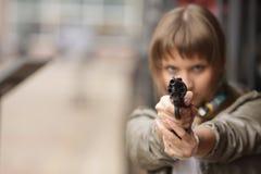 Muchacha y arma Foto de archivo libre de regalías