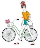 Muchacha y bicicleta bonitas Fotos de archivo libres de regalías
