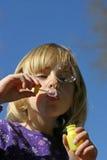 Muchacha y burbujas Imagen de archivo libre de regalías