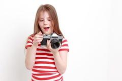 Muchacha y cámara Imágenes de archivo libres de regalías