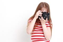 Muchacha y cámara Fotografía de archivo libre de regalías