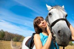 Muchacha y caballo Foto de archivo libre de regalías
