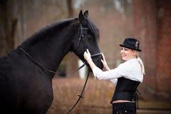 Muchacha y caballo Imagen de archivo libre de regalías