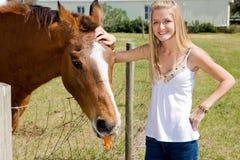 Muchacha y caballo de granja Foto de archivo libre de regalías